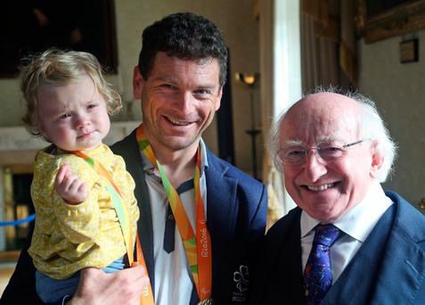 President Higgins with with double medal winning Paralympian, Eoghan Clifford his daughter Zofia at Áras an Uachtaráin. Photo: Colin Keegan
