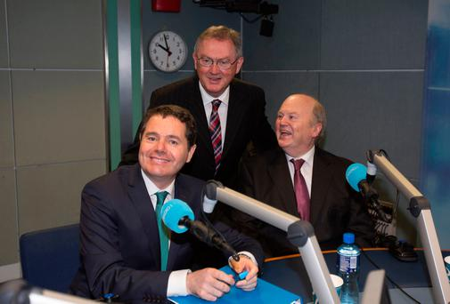 Minister for Public Expenditure Paschal Donohoe with Sean O'Rourke, centre, and Finance Minister Michael Noonan in RTE. Photo: Mark Condren