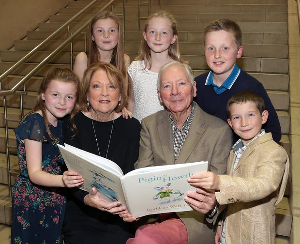 Kathleen Watkins with her grandchilden Sadhbh, Saoirse, Kate,Harry, and Cian and husband Gay Byrne at the launch of Kathleen's new childrens book, Pigín of Howth, at The National Gallery of Ireland. Picture:Brian McEvoy