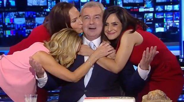 Colleagues hug Eamonn Holmes on his last day at Sunrise before he is cut off