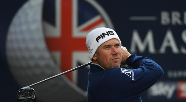 Lee Westwood hits his tee shot on the 14th hole during the first round of the British Masters at The Grove (Photo by Ross Kinnaird/Getty Images)
