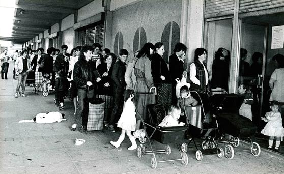Changing times: Mothers queue outside Ballymun post office to collect Child Benefit in 1984. A decade earlier, only men could collect the allowance