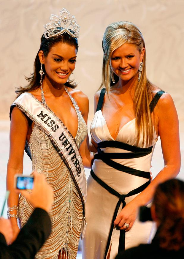 Miss Puerto Rico Zuleyka Rivera Mendoza (L) poses with show host Nancy O'Dell on stage after being named Miss Universe during the Miss Universe 2006 pageant at the Shrine Auditorium on July 23, 2006 in Los Angeles, California. (Photo by Stephen Shugerman/Getty Images)