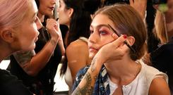 Model Gigi Hadid prepares backstage at the Anna Sui fashion show during New York Fashion Week: The Shows at The Arc, Skylight at Moynihan Station on September 14, 2016 in New York City. (Photo by Astrid Stawiarz/Getty Images for New York Fashion Week: The Shows)