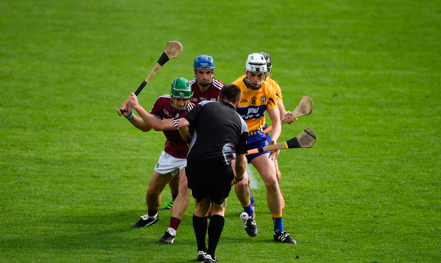 Brian Gavin throws the ball in to start the second half between David Burke, left, and Davy Glennon of Galway and Conor Cleary, left, and David Reidy of Clare during the GAA Hurling All-Ireland Senior Championship quarter final match between Clare and Galway