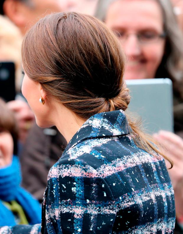 Catherine, Duchess of Cambridge, hair detail, meets wellwishers after touring the National Football Museum during her visit to Manchester on October 14, 2016 in Manchester, England. (Photo by Chris Jackson/Getty Images)