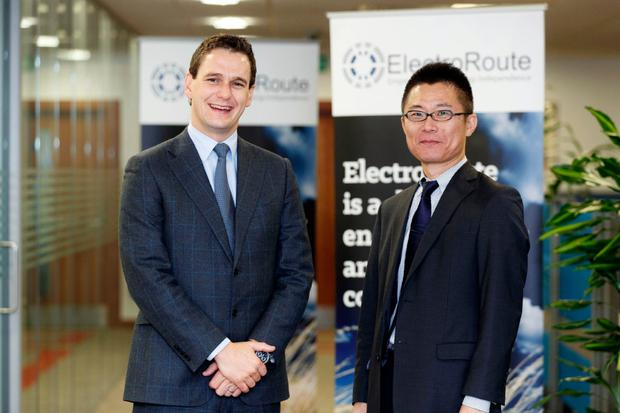 Pictured at the announcement is Ronan Doherty CEO, ElectroRoute with Atsushi Suzuki, Head of Power Business Planning Office, New Energy & Power Generation Division, Mitsubishi Corporation. Picture Andres Poveda