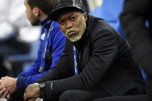 Bastia French forward Djibril Cisse watches play on April 11, 2015 during a French League Cup final football match Bastia (SCB) vs. Paris Saint-Germain, at the Stade de France in Saint-Denis, outside Paris. AFP PHOTO / LOIC VENANCE (Photo credit should read LOIC VENANCE/AFP/Getty Images)