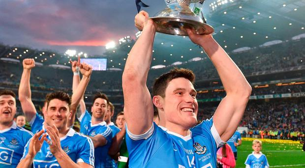 Diarmuid Connolly raises the Sam Maguire to fans after Dublin's replay win over Mayo. Photo: David Maher/Sportsfile