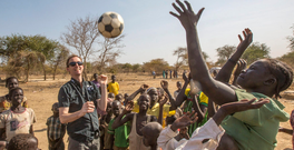 Goal's Barry Andrews playing football with children in the Twic County of South Sudan in 2014 Photo: Mark Condren