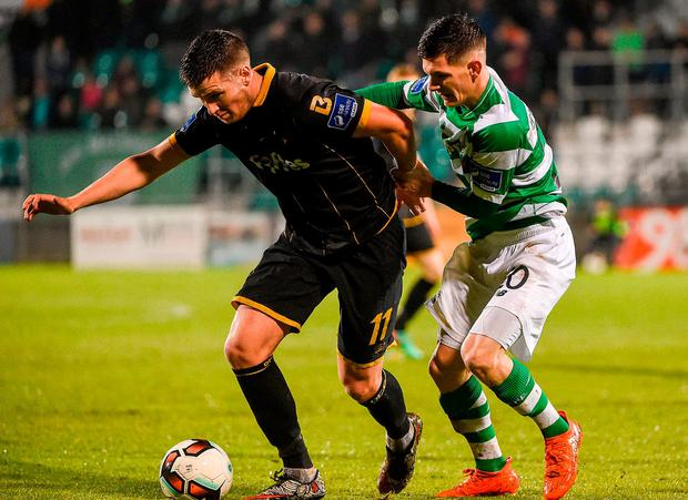 Dundalk's John McEleney in action against Shamrock Rovers' Trevor Clarke. Photo: David Maher/Sportsfile