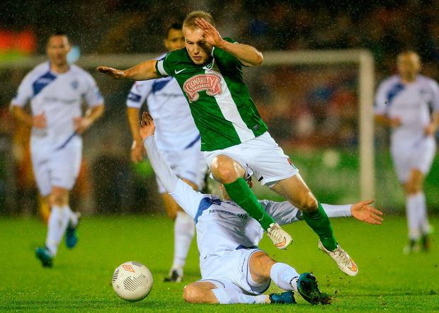 Cork City's Stephen Dooley in action against Finn Harps' Mark Hughes. Photo: Eóin Noonan/Sportsfile