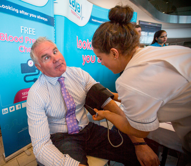 Brent Pope jokes about as he gets his blood pressure checked by nurse Aoife Kiernan at the Laya Healthcare Mental Health Summit at the Aviva Stadium Photo: Mark Condren