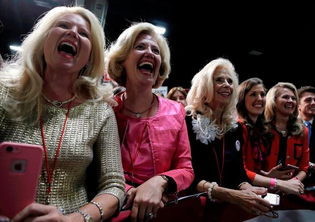 Supporters of Republican U.S. presidential nominee Donald Trump cheer as Trump takes the stage at a campaign rally in Charlotte, North Carolina, U.S., October 14, 2016. REUTERS/Mike Segar