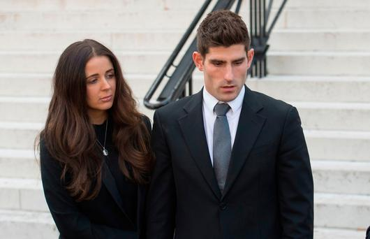 Chesterfield's Ched Evans leaves Cardiff Crown Court with partner Natasha Massey