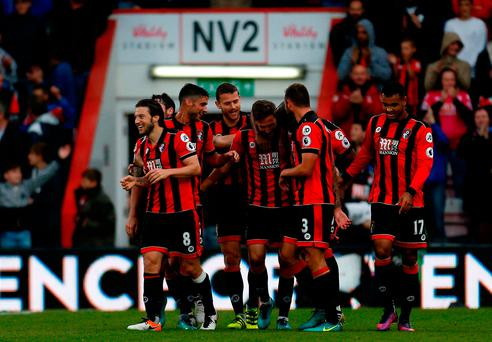 AFC Bournemouth's Dan Gosling (centre) celebrates scoring his side's sixth goal