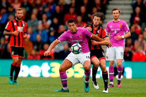 AFC Bournemouth's Tyrone Mings (left) and AFC Bournemouth's Harry Arter