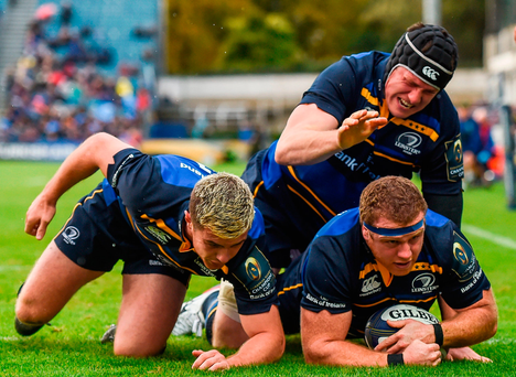 Sean Cronin of Leinster goes over to score his side's first try, alongside team-mates Luke McGrath, left, and Ian Nagle
