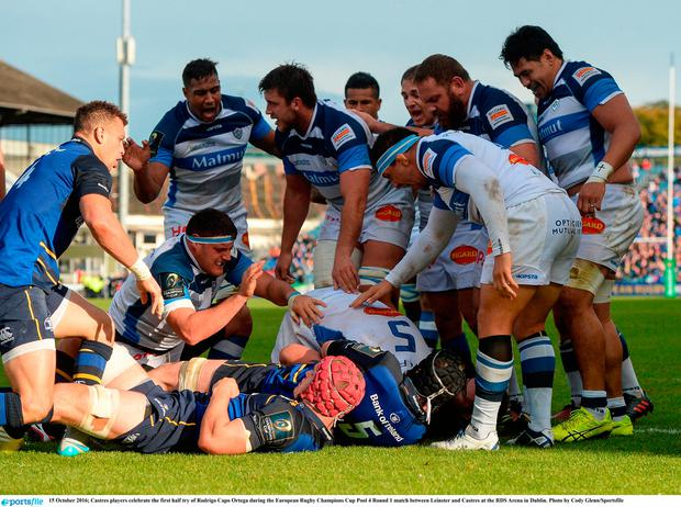 Castres players celebrate the first half try of Rodrigo Capo Ortega