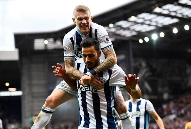 West Bromwich Albion's Nacer Chadli celebrates scoring their first goal with James McClean