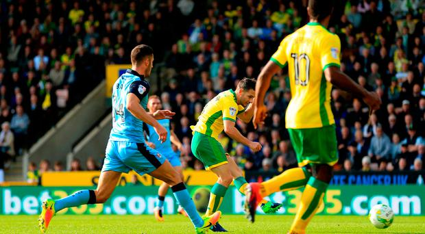 Wes Hoolahan of Norwich City scores the opening goal