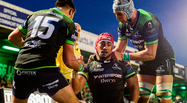 Bundee Aki, centre, of Connacht is congratulated by teammates Tiernan O'Halloran, left, and Ultan Dillane, right, after scoring his side's third try