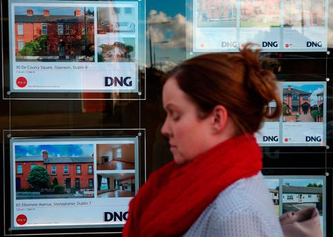 An estate agents shop window in Dublin as a new help-to-buy scheme for first-time house buyers struggling to get on the property ladder was announced in the Budget. Photo: Brian Lawless/PA