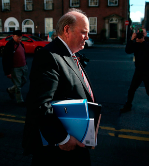 Finance Minister Michael Noonan makes his way to Government buildings in Dublin to deliver the Budget Photo: Brian Lawless/PA Wire