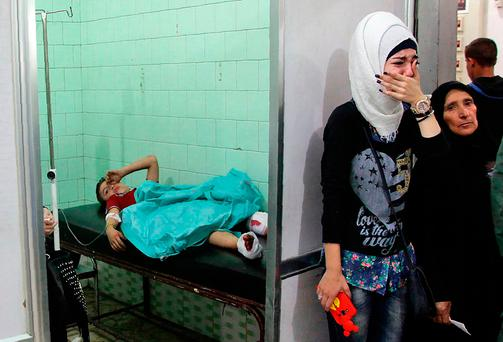 The bigger picture: A Syrian boy receives treatment at a hospital in the regime-held part of Aleppo last Thursday. Syrian state television said four children were killed by rebel rocket fire on a school in a western regime-held neighbourhood Photo: GEORGE OURFALIAN / AFP / Getty Images