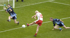 Having left Stephen O'Shaughnessy stranded, Tyrone's Owen Mulligan puts the ball past Dublin keeper Stephen Cluxton for his side's second goal in the 2005 All-Ireland quarter-final replay. Photo: Ray McManus/Sportsfile