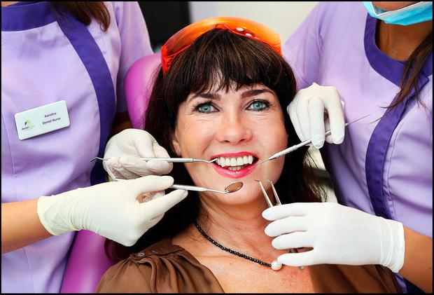 Victoria Mary Clarke sits in the dentist's chair for the first time in her adult life and gets five teeth removed Photo: Steve Humphreys