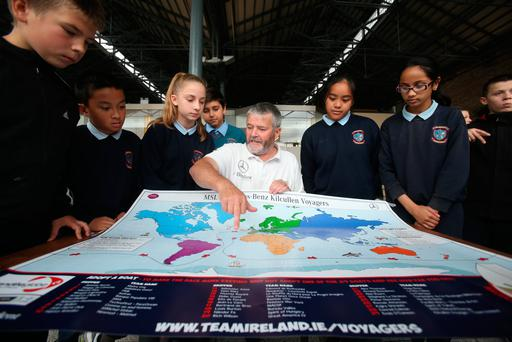 Students from St Mary's NS, Dublin, are shown the round-the-world route on the MSL Mercedes-Benz Kilcullen Voyagers map by skipper Enda O'Coineen