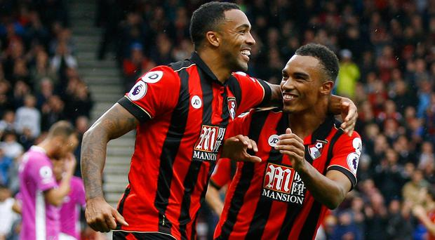 Bournemouth's Callum Wilson celebrates scoring their fifth goal with Junior Stanislas. Picture: Reuters