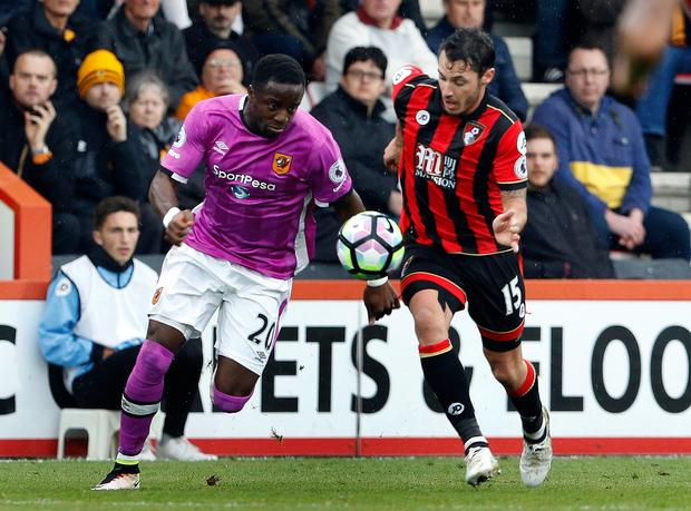 Hull City's Adama Diomande in action with Bournemouth's Adam Smith. Picture: Reuters