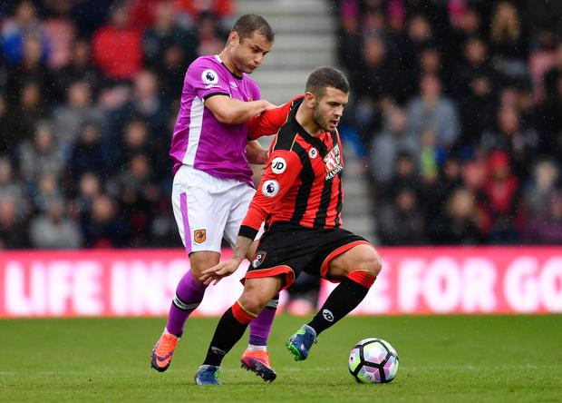 Bournemouth's Jack Wilshere fends off Hull City's Shaun Maloney. Picture: Reuters