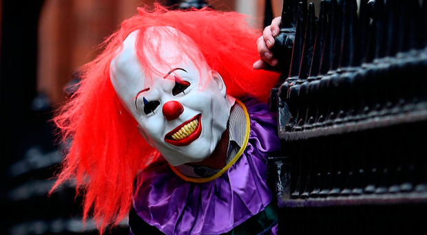 Pranksters dressing up as creepy clowns to frighten unsuspecting onlookers has become a global phenomenon (picture posed) Photo: Peter Byrne/PA Wire