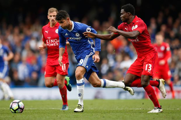 Chelsea's Diego Costa bursts past Leicester City's Daniel Amartey and Marc Albrighton (left) Picture: Reuters