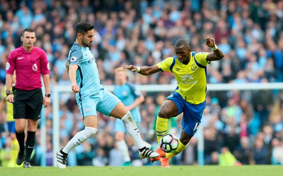 Everton's Yannick Bolasie and Manchester City's Ilkay Gundogan challenge for the ball. Picture: PA