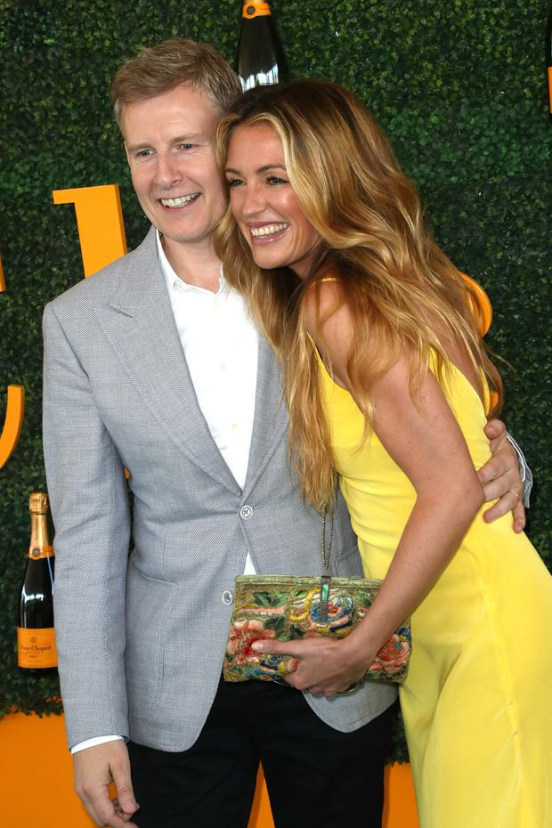 Comedian Patrick Kielty (L) and TV personality Cat Deeley arrive at the 7th Annual Veuve Clicquot Polo Classic at Will Rogers State Historic Park on October 15, 2016 in Pacific Palisades, California. (Photo by David Livingston/Getty Images)