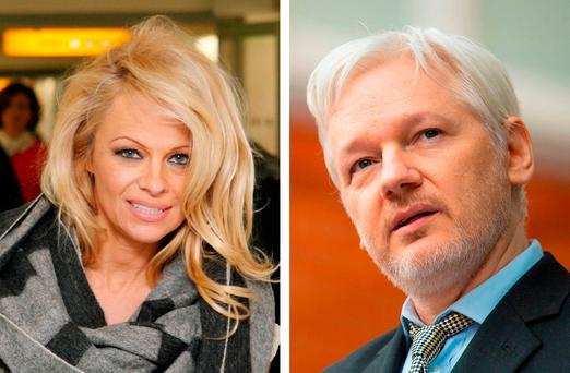 Pamela Anderson and Julian Assange, as she has revealed her fears over his health after visiting him at the Ecuadorian Embassy Credit: Steve Parsons/PA Wire