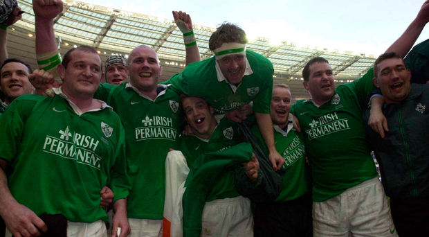 Irish players, l to r, Peter Clohessy, John Hayes, Kevin Maggs, Denis Hickie, Frank Sheahan, Anthony Foley and Justin Fitzpatrick celebrate Ireland's win over France
