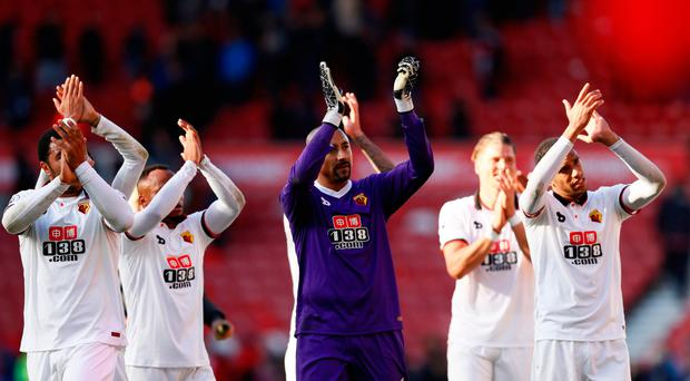 Watford's Heurelho Gomes applauds fans with team mates at the end of the match