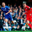 Leicester City's English striker Jamie Vardy (R) passes the ball Photo Adrian Dennis/Getty Images