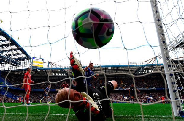 Diego Costa of Chelsea scores his sides first goal past Kasper Schmeichel of Leicester City. Photo by Shaun Botterill/Getty Images