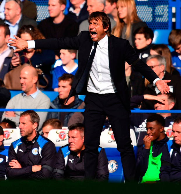 Chelsea's Italian head coach Antonio Conte gestures on the touchline. Photo: Glyn Kirk/Getty Images