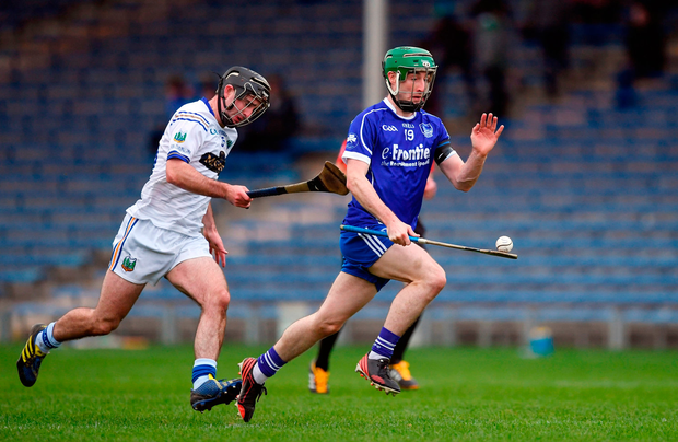 Tommy Doyle of Thurles Sarsfields gets away from Tadhg Gallagher of Kiladangan during the Tipperary SHC final at Semple Stadium. Photo: Sportsfile