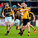 Paraic O'Loughlin of Clonlara in action against Stan Lineen of Ballyea. Photo: Sportsfile