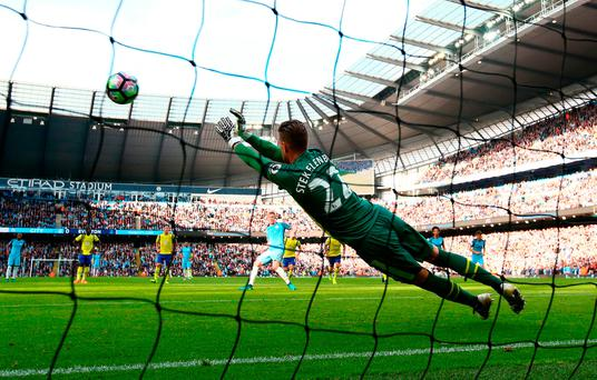 Everton's Maarten Stekelenburg saves Kevin De Bruyne's penalty kick at the Etihad Stadium. Photo by Alex Livesey/Getty Images