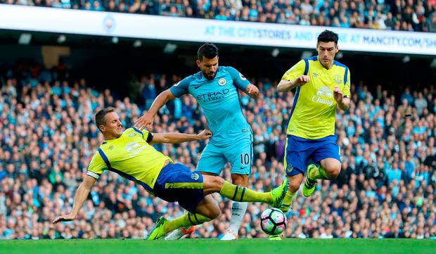 Everton's Phil Jagielka fouls Manchester City's Sergio Aguero which results in a penalty. Photo credit: Martin Rickett/PA Wire.
