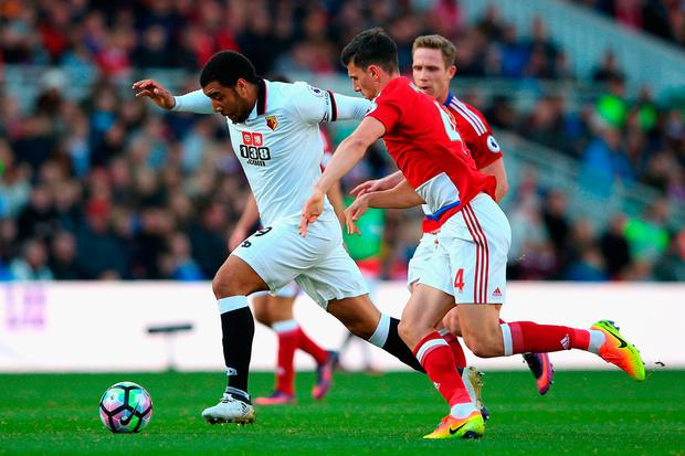 Troy Deeney of Watford is chased down by Daniel Ayala of Middlesbrough. Photo by Alex Livesey/Getty Images
